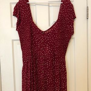A red with white polka dots dress